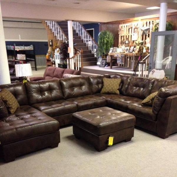 Transform your living room with this gorgeous sectional and ottoman.