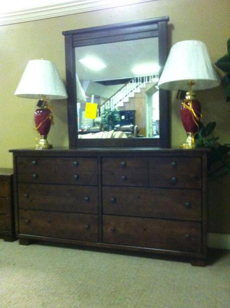Adorn any space with this beautiful wood dresser