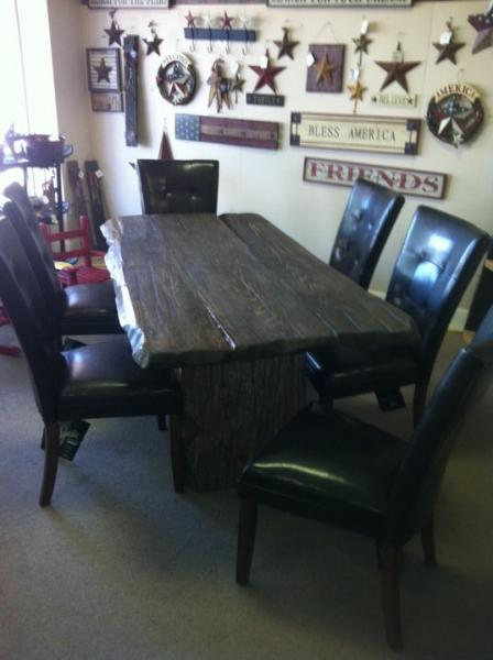 Enchant your dinning with a rustic table and cozy chairs.